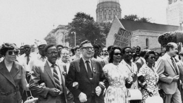 Joseph E. Lowery, second left, Coretta King, centre, help lead several thousand marchers past the state Capitol in Atlanta in a protest march against war, violence and racial repression.