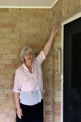 Pensioner Margaret Singleton points out problems at her Lakes Entrance home.