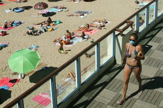 Bikinis and face masks in Saint Jean de Luz, south-western France, during the 2020 European summer.