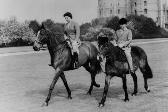 The Queen and the Prince of Wales riding at Windsor Castle in 1961.