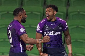 Melbourne winger Josh Addo-Carr celebrates after scoring a try on Friday night.