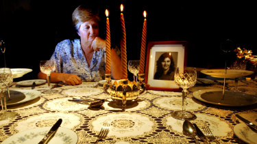 Trish Riggs' mother Carol Saxton at home in Queanbeyan in 2003. Her daughter made the tablecloth and Mrs Saxton always laid it out at Christmas. Mrs Saxton died in 2011, not knowing what happened to her daughter.