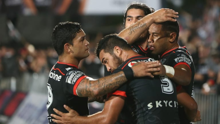 New Zealand Warriors players celebrate a try against the North Queensland Cowboys in round five.