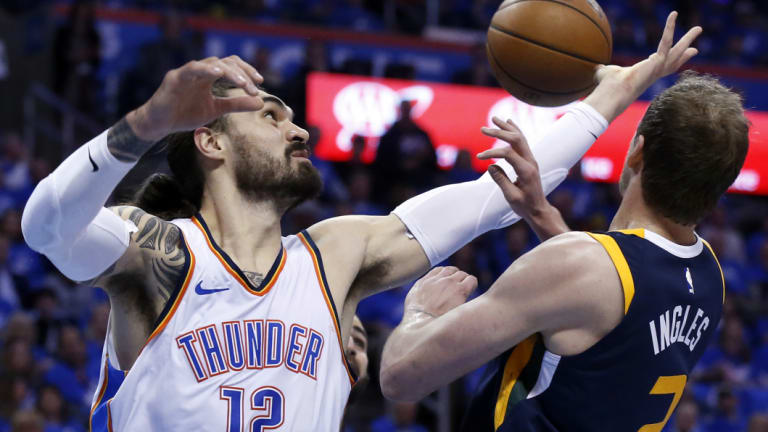 Thunder centre Steven Adams (right) gets into the contest with Utah's Joe Ingles.