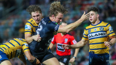 Big defensive effort: The Eels try to round up the Cowboys' Coen Hess in  Townsville.