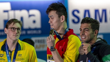 Mack Horton (left) made his point against Sun Yang (centre).