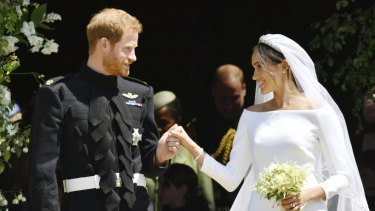Prince Harry and Meghan Markle on the steps of St George's Chapel in Windsor Castle after their wedding ceremony.