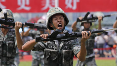 Chinese People's Liberation Army soldiers demonstrate their skill during an open day of Stonecutter Island naval base, in Hong Kong in June.