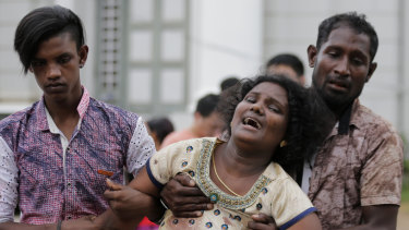 Relatives of victims in Colombo on Sunday.