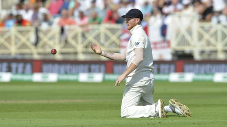 On his knees: England's Ben Stokes fields during the first day of the third Test against India at Trent Bridge.