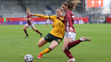 WIESBADEN, GERMANY - APRIL 10: Alanna Kennedy of Australia and Jule Brand of Germany battle for the ball during the Women's International Friendly match between Germany and Australia at BRITA-Arena on April 10, 2021 in Wiesbaden, Germany. Sporting stadiums around Germany remain under strict restrictions due to the Coronavirus Pandemic as Government social distancing laws prohibit fans inside venues resulting in games being played behind closed doors.  (Photo by Joosep Martinson/Getty Images)