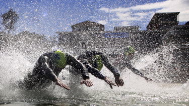 "Ocean swimmer Andre Slade and members of his ""OceanFit"" group hit the water at Bondi Beach on Saturday."