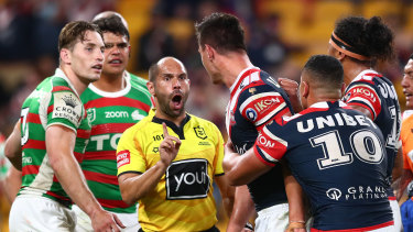 Roosters centre Joseph Manu confronts South Sydney's Latrell Mitchell.