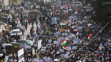 Indians march during a protest against the Citizenship Act in Mumbai on Wednesday.