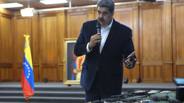 President Nicolas Maduro displays military communications equipment he said was seized during an incursion into Venezuela in May. Maduro maintains the US is trying to overthrow him.
