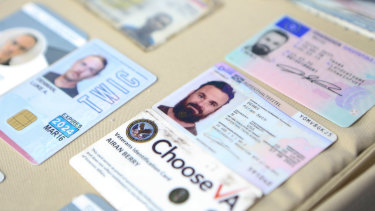 Venezuelan authorities show what they say are the ID cards of former US special forces citizen Airan Berry, right, and Luke Denman, left, in Caracas, Venezuela.