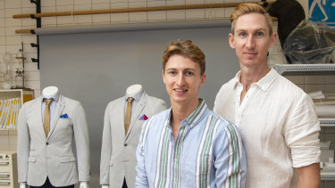 Craig Burns (right) and Luke Sullivan with their wedding suits which they are donating to the Queensland Museum's social history collection.