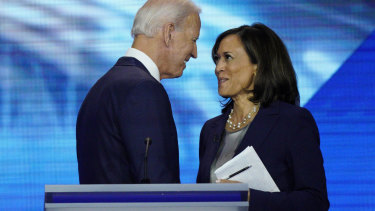 Joe Biden and Kamala Harris shake hands after a Democratic presidential primary debate in September last year.