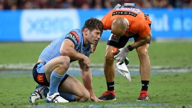 Cameron Murray was floored after copping a tackle to the head from Queensland Kyle Feldt in the second half.