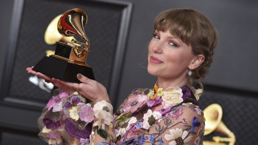 Swift with her award for Album of the Year for Folklore at the 63rd annual Grammy Awards in Los Angeles on March 14.