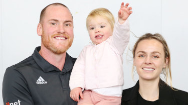 Retiring footballer Jarryd Roughead with his wife Sarah and daughter Pippa.