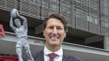 Former Queensland and Wallabies captain John Eales stands next to a model of a statue of himself at Suncorp Stadium.