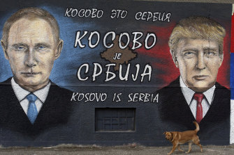 "A graffiti depicting the Russian President Vladimir Putin and US President Elect Donald Trump with Cyrillic script that reads ""Kosovo is Serbia"" in a suburb of Belgrade, Serbia in 2016."