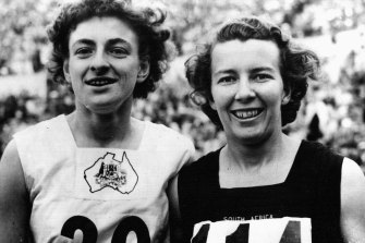 Marjorie Jackson (left) and Daphne Hasenjager of South Africa, winner and runner-up, after the 100m final in Helsinki.