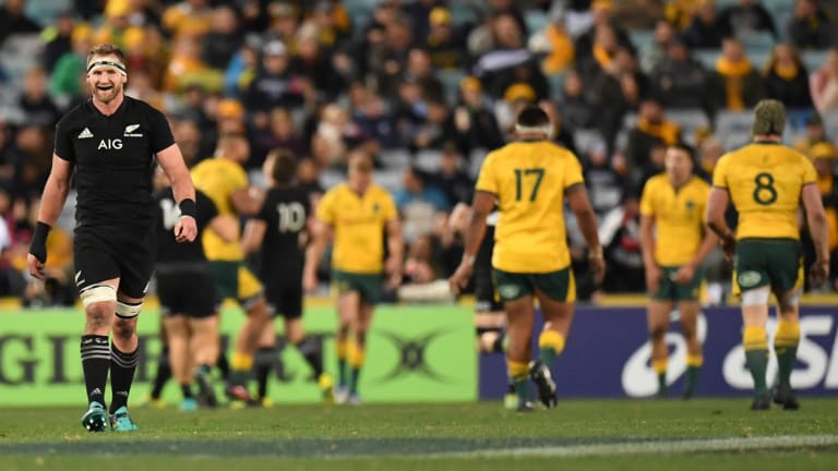 The great divide: Kieran Read reacts after the All Blacks score another try against the Wallabies in Sydney.