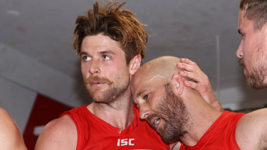 Dane Rampe comforts the retiring Jarrad McVeigh after Saturday's emotional win over St Kilda.