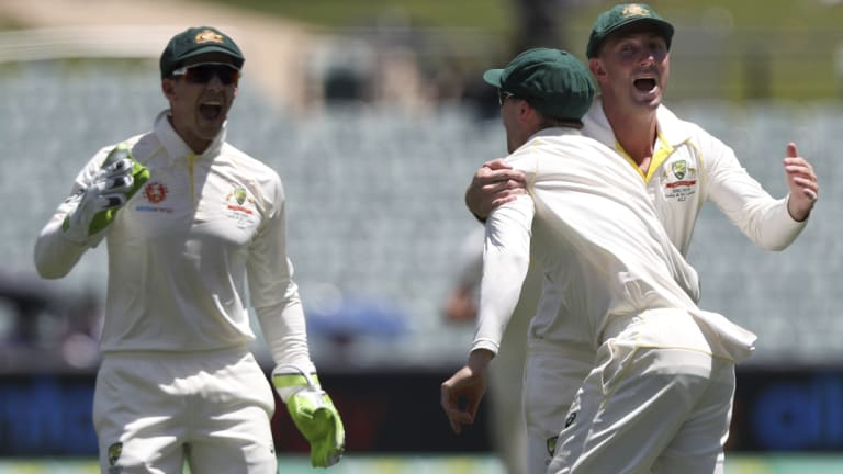 Shrewd management: Peter Handscomb, centre, is congratulated by Shaun Marsh and Tim Paine after taking a catch to dismiss Ajinkya Rahane off the bowling of Josh Hazlewood.