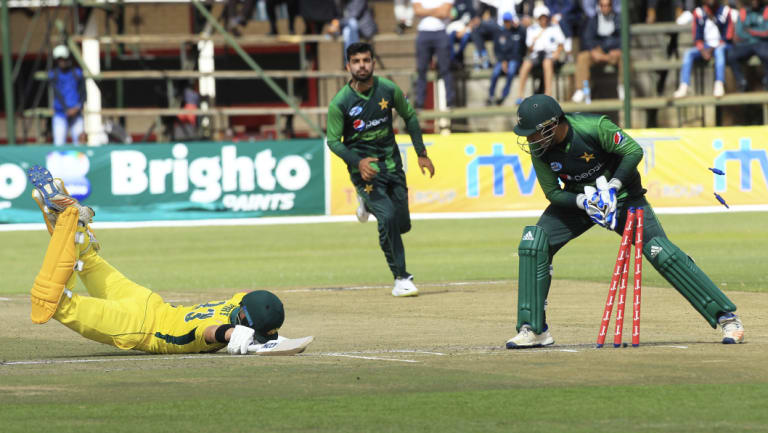 Close call: D'Arcy Short dives to avoid a run out at the Harare Sports Club.