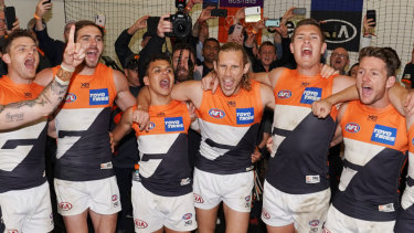 Delerium: GWS players sing the club song after beating Collingwood to qualify for their first grand final.