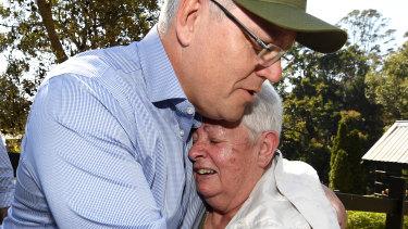 Prime Minister Scott Morrison consoles bushfire victim Pamela Skeen, who lost her home at Binna Burra in the Gold Coast hinterland.