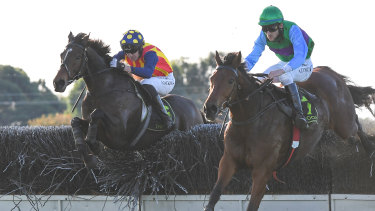 Shane Jackson rides Ablaze (left) to victory from Zed Em in Tuesday's Grand Annual Steeple at Warrnambool.