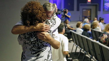 Dennis Padgett embraces Sandra Deadwyler during a vigil for the victims of the mass shooting.