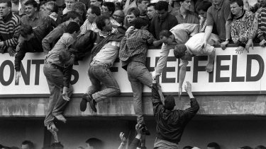 Liverpool fans trying to escape during the Hillsborough disaster at Hillsborough football stadium in Sheffield.