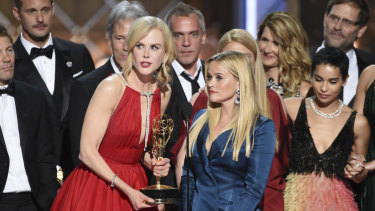 """Nicole Kidman, left, and Reese Witherspoon accept the award for outstanding limited series for """"Big Little Lies"""" at the 69th Primetime Emmy Awards last year."""