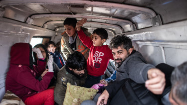 Refugees and migrants sit in the back of a van as they prepare to head to the shores of the Evros river to attempt to enter Greece from Turkey.