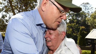 Prime Minister Scott Morrison consoles bushfire victim Pamela Skeen, who lost her home at Binna Burra in the Gold Coast hinterland.