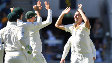 Pat Cummins (right) of Australia celebrates with team mates after getting the wicket of Lahiru Thirimanne of Sri Lanka during day three of the first Test match between Australia and Sri Lanka at the Gabba in Brisbane, on January 26, 2019.