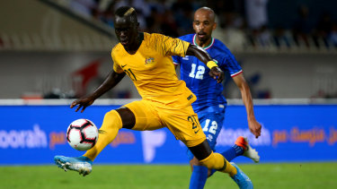 Close control: The typically dynamic Awer Mabil on the ball against Kuwait.