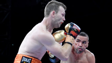 Hit and miss: Anthony Mundine lands a rare punch against Jeff Horn in Brisbane.