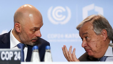 UN Secretary-General Antonio Guterres, right, talks to UN climate conference president, Poland's Deputy Environment Minister Michal Kurtyka.