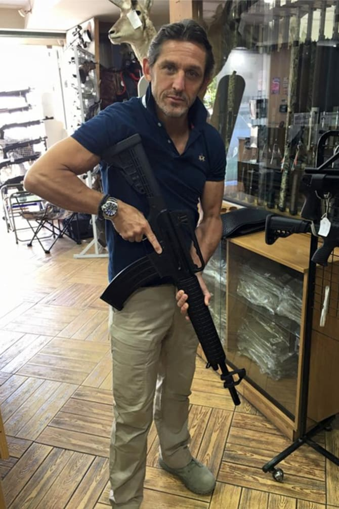 Christian Madison, pictured here with an assault rifle, put Hartford Investments into administration with debts of more than $5 million just weeks after Peter Larcombe's death.