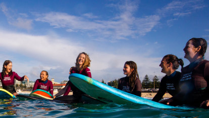 'Appointment with the ocean': surfie sisterhood blows male counterparts out of the water