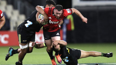 Back in action: Crusaders star Ryan Crotty runs the ball for the Christchurch club.