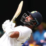 Cheteshwar Pujara bats on day three of the fourth Test at the Gabba.