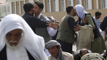 Men hug each other after Eid al-Fitr prayers outside of Shah-e-Dushamshera mosque in Kabul, Afghanistan, on Friday.