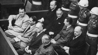 The defendants in the dock: [front row, L-R]:Hermann Goering,Rudolf Hess,Joachim von Ribbentrop,Wilhelm Keitel. [second row, L-R]:Karl Dönitz,Erich Raeder,Baldur von Schirach,Fritz Sauckel.